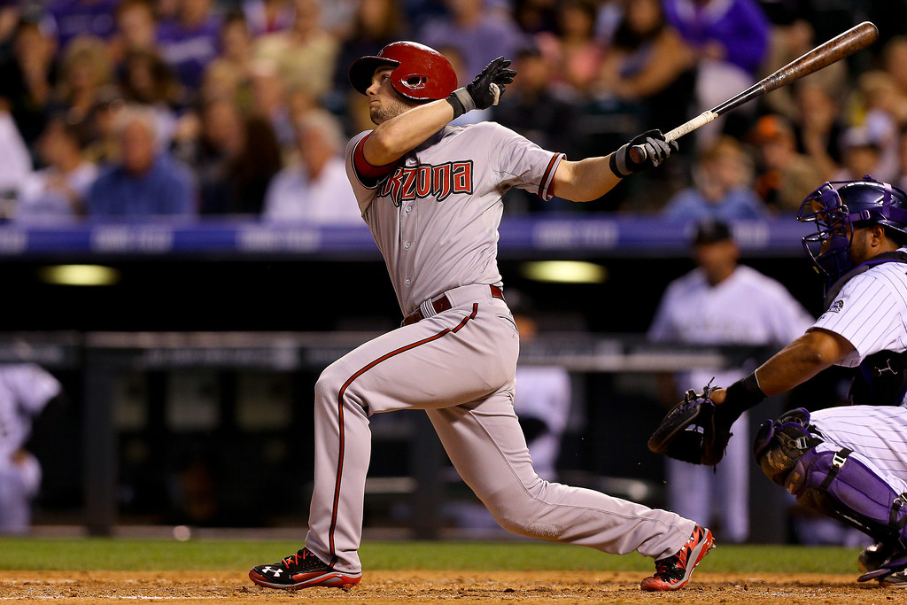 . Chris Owings #16 of the Arizona Diamondbacks hits a sacrifice fly, scoring a run in the sixth inning against the Colorado Rockies at Coors Field on June 5, 2014 in Denver, Colorado.  (Photo by Justin Edmonds/Getty Images)