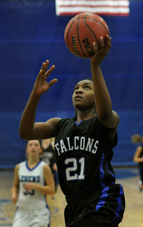 . PARKER, CO. - FEBRUARY 15: Ranch point guard Symone Starks (21) added an easy lay up in the second half. The Highlands Ranch High School girls\'s basketball team defeated Legend 76-31 Friday night, February 15, 2013. Falcon\'s coach Caryn Jarocki earned her 500th career win. (Photo By Karl Gehring/The Denver Post)