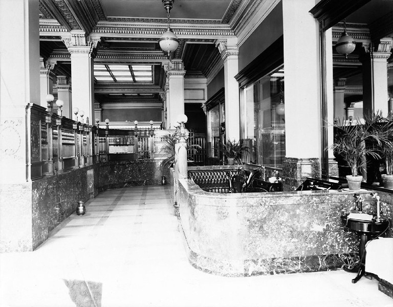 Interior view of the Securities First Savings Bank on the corner of Fourth Street and Spring Street in Los Angeles, 1909