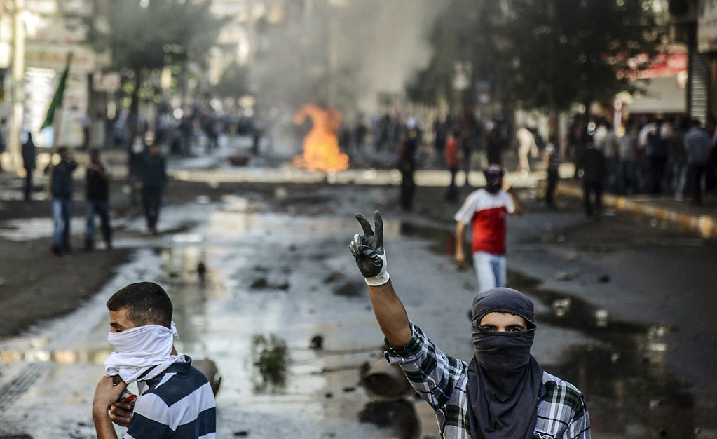. Kurdish protesters clash with Turkish riot policemen in the southeastern city of Diyarbakir on October 7, 2014. INILYAS AKENGIN/AFP/Getty Images