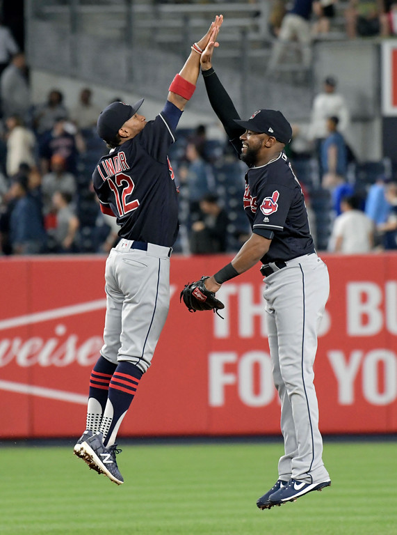 . Cleveland Indians shortstop Francisco Lindor, left, and left fielder Austin Jackson celebrate after the Indians defeated the New York Yankees 6-2 in a baseball game Monday, Aug. 28, 2017, at Yankee Stadium in New York. (AP Photo/Bill Kostroun)