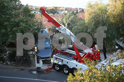 careening-car-ends-up-on-roof-of-southern-california-house