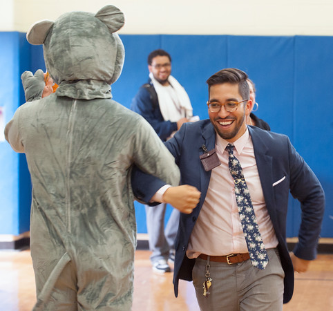 06/01/18 Wesley Bunnell | Staff Lincoln Elementary School Vice Principal Orlando Ruiz dances with a mouse during the schools One School, One Book event on Friday afternoon. giving every student the same book, The Mouse on the Motorcycle, to bring home to be read with their parents. The books were wrapped with the title kept a secret until being passed out.