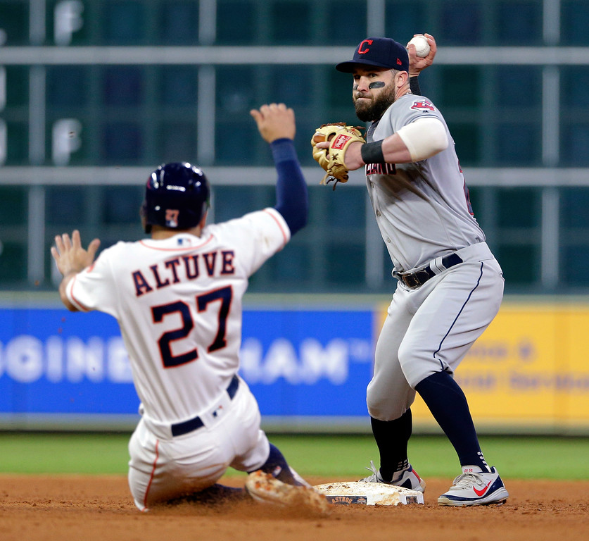 . Houston Astros Jose Altuve (27) is out at second base as Cleveland Indians second baseman Jason Kipnis tries to turn a double play during the eighth inning of a baseball game Sunday, May 20, 2018, in Houston. (AP Photo/Michael Wyke)