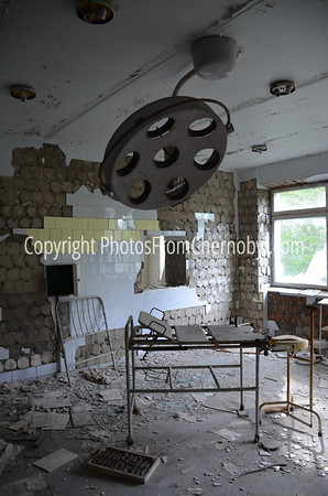 Abandoned gynecology procedure table inside the hospital in Pripyat, the ruined town that housed workers from the Chernobyl Nuclear Plant.