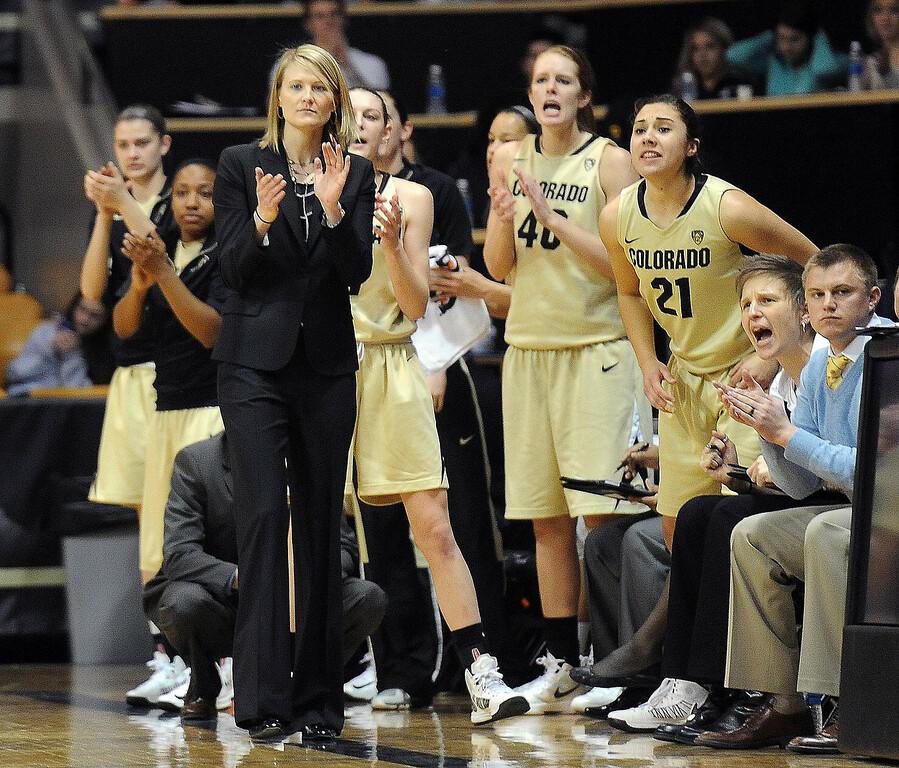 . CU head coach, Linda Lappe, encourages her team against Oregon. Cliff Grassmick / February 10, 2013