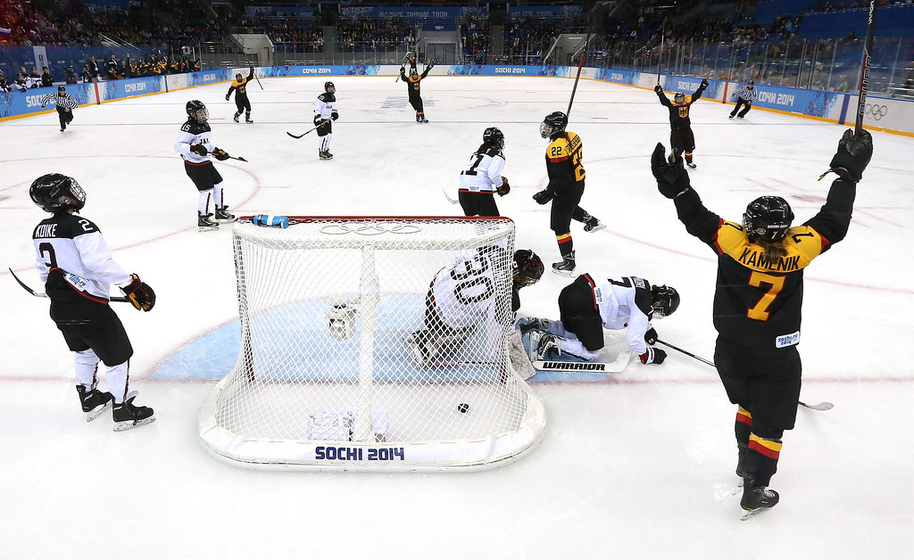 . SONina Kamenik #7 of Germany celebrates after a goal by Kerstin Spielberger #22 against Nana Fujimoto #30 of Japan in the third period during the women\'s Ice Hockey Preliminary Round Group B game on day six of the Sochi 2014 Winter Olympics at Shayba Arena on February 13, 2014 in Sochi, Russia.  (Photo by Robert Cianflone/Getty Images)