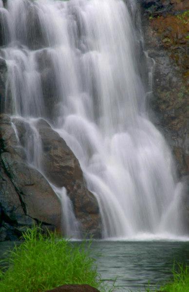 Close-up of Waimae FallsThe 40-foot Waimae Falls cascades down the rocks into the Kamananui Stream that flows through Waimae Valley, into the adjacent white sandy beach of Waimea Bay and into the ocean.North Shore of Oahu, Hawaii
