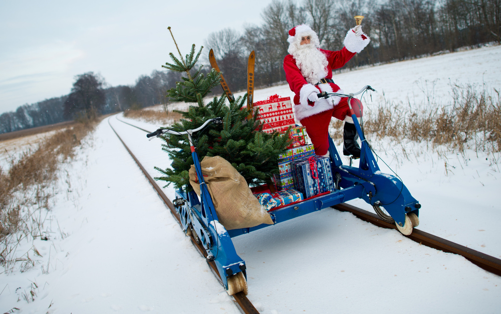 Description of . A Santa Claus rides with Christmas presents on December 12, 2012 in Mellensee, eastern Germany.  PATRICK PLEUL/AFP/Getty Images
