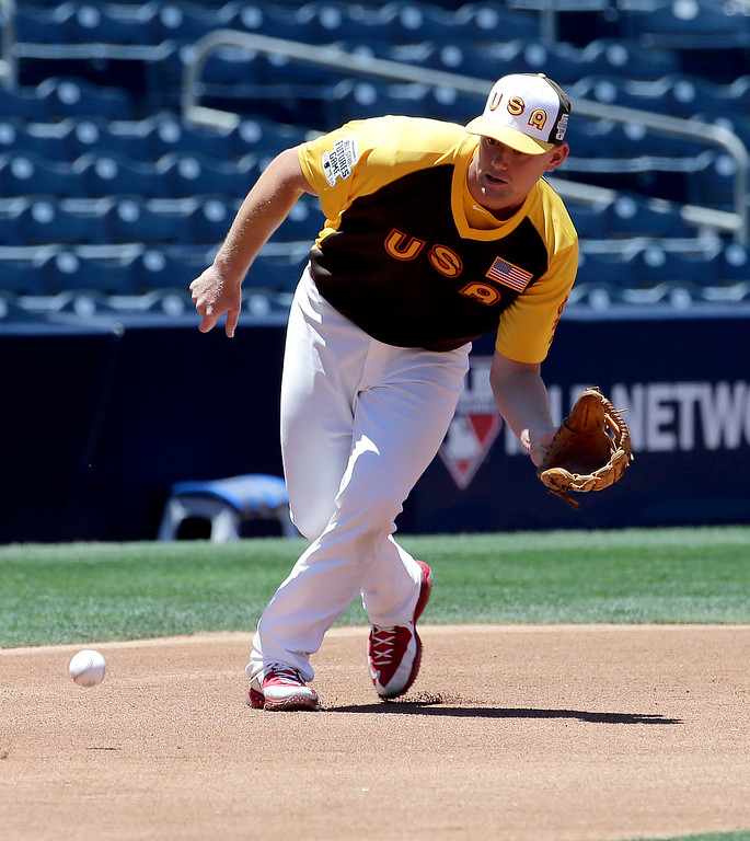 . U.S Team\'s Carson Kelly, of the St. Louis Cardinals, fields a ball during warm ups prior to the All-Star Futures baseball game against the World team, Sunday, July 10, 2016, in San Diego. (AP Photo/Matt York)