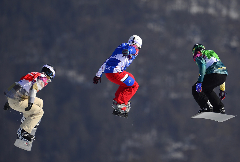 . (L-R) US Lindsey Jacobellis, France\'s Nelly Moenne Loccoz, and Australia\'s Belle Brockhoff compete in the Women\'s Snowboard Cross Small Final at the Rosa Khutor Extreme Park during the Sochi Winter Olympics on February 16, 2014.     JAVIER SORIANO/AFP/Getty Images