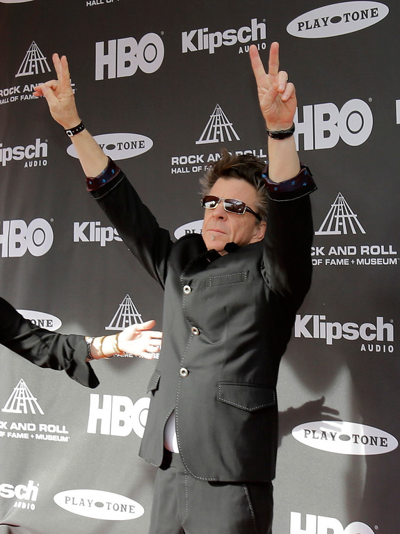 . Chris Layton, of Double Trouble, greets the fans at his arrival at the Rock and Roll Hall of Fame Induction Ceremony Saturday, April 18, 2015, in Cleveland. (AP Photo/Tony Dejak)