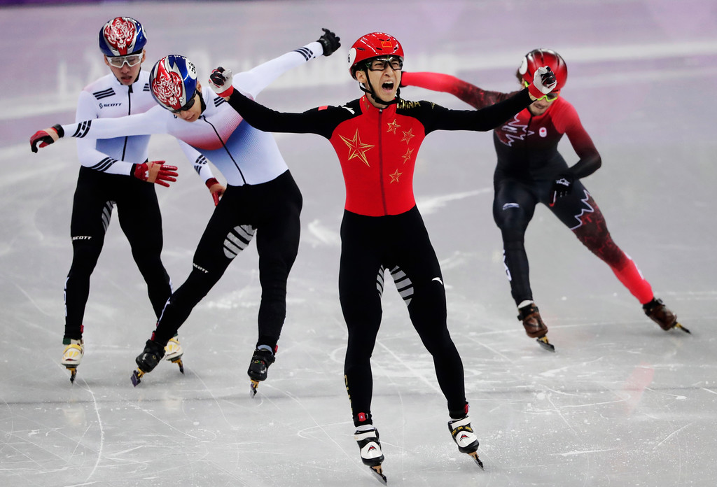 . Wu Dajing of China celebrates after winning the men\'s 500 meters short track speedskating A final in the Gangneung Ice Arena at the 2018 Winter Olympics in Gangneung, South Korea, Thursday, Feb. 22, 2018. (AP Photo/Julie Jacobson)