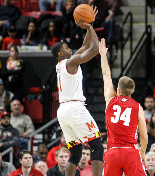 January 20, 2018: Maryland guard Darryl Morsell (11) shoots over Wisconsin guard Brad Davison (34) during BIG Ten Men Basketball action between University of Wisconsin and University of Maryland in College Park. Photo by: Chris Thompkins/Prince Georges Sentinel