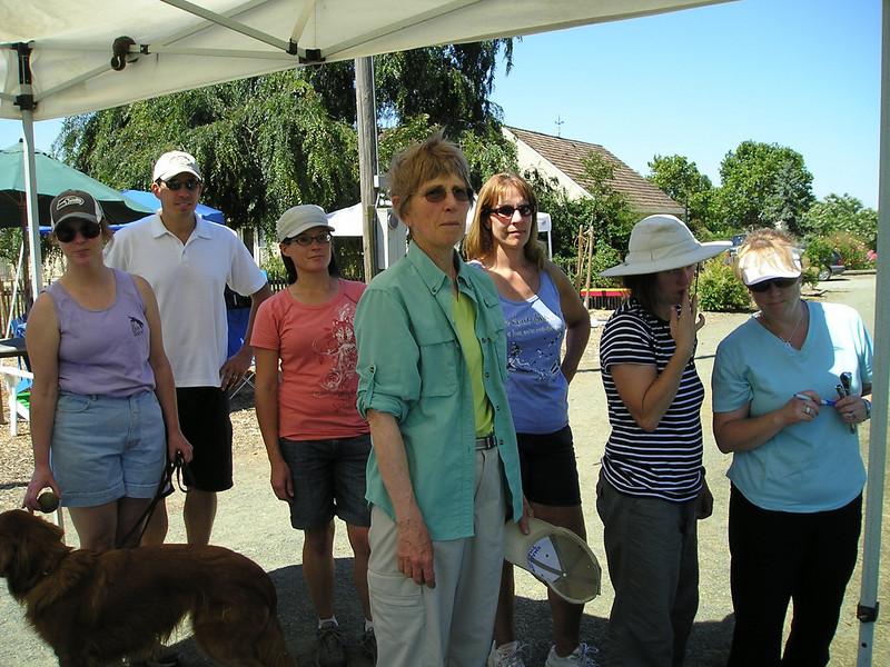 Everyone huddles under the canopy while waiting their turns. (Mary, Matt, Jennifer, Jean, ?, Elissa, Deanna)