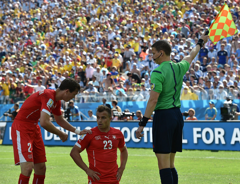 . Switzerland\'s midfielder Xherdan Shaqiri (C) looks on as the linesman raises the flag during a Round of 16 football match between Argentina and Switzerland at Corinthians Arena in Sao Paulo during the 2014 FIFA World Cup on July 1, 2014. (NELSON ALMEIDA/AFP/Getty Images)