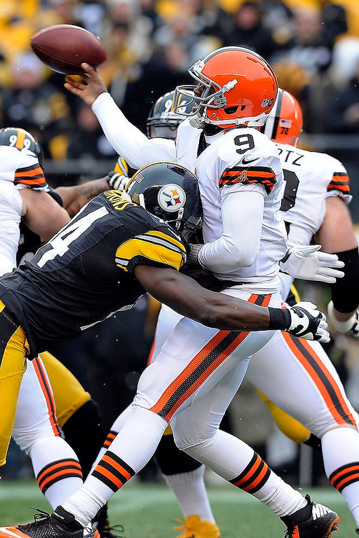 . Pittsburgh Steelers inside linebacker Lawrence Timmons (94) hits Cleveland Browns quarterback Thad Lewis as Lewis passes in the first quarter an NFL football game on Sunday, Dec. 30, 2012, in Pittsburgh. (AP Photo/Don Wright)