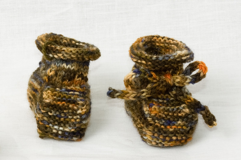 Stay-On Baby Booties, from Knitting For Baby. In Lisa Souza Sock!, Petroglyph colorway. (The left one's tie has since been completed and added.)