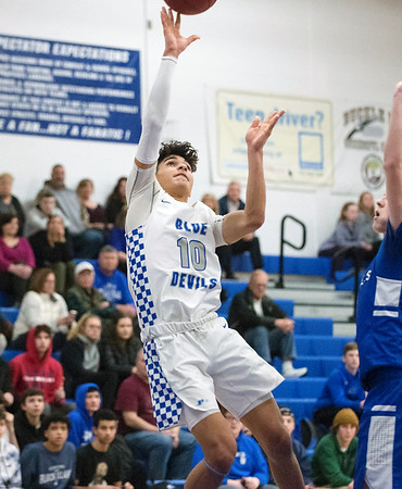 02/11/20 Wesley Bunnell | StaffrrPlainville boys basketball at home on Tuesday night against Lewis Mills. Brennan Staubley (10) with a rebound and put back.