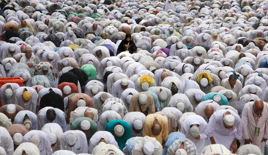 . Muslim pilgrims pray on a street near the Grand Mosque in the Muslim holy city of Mecca, Saudi Arabia, Thursday, Oct. 10, 2013. The Muslim annual hajj, or pilgrimage, is expected to draw millions. Every Muslim is required to perform the hajj to Mecca at least once in his or her lifetime if able to do so. (AP Photo/Amr Nabil)