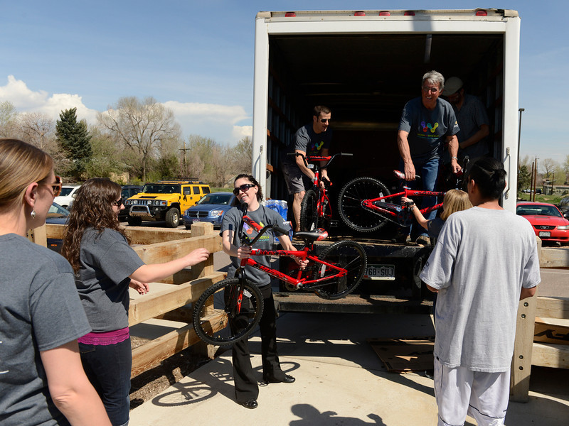 . Volunteers for Wish for Wheels unload bikes at Sable Elementary in Aurora, May 14, 2013. Panera Bread and Wish for Wheels, a local non-profit, donated 140 new bikes to benefit area kindergarteners around Denver. (Photo By RJ Sangosti/The Denver Post)