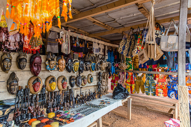 Roadside kiosk selling African Arts, crafts, culture, carvings, masks, and gift materials  in Yamoussoukro Ivory Coast, Cote d'Ivoire.