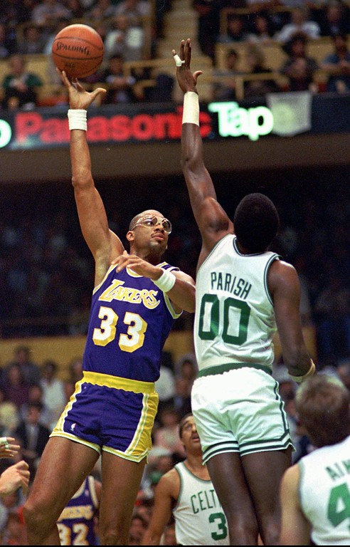 """. Los Angeles Lakers center Kareem Abdul-Jabbar displays his famous \""""sky-hook\"""" shot as Boston Celtics center Robert Parrish (00) defends on Dec. 11, 1987, at the Boston Garden. Some day, if the lawyers have their way, athletes will be attaching ``Patent Pending,\'\' notices to their signature moves, the plays and ploys that are unique to them.(AP Photo.  This could come under the category of intellectual property, and the attorneys at Pennie & Edmonds, a New York-based firm specializing in that area of thelaw, are entirely serious. One of the firms lawyers cited the example of the skyhook.  (AP Photo/Carol Francavilla, file)"""