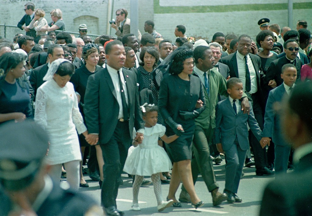. Coretta Scott King, center, widow of slain civil right Dr. Martin Luther King, Jr. walk in the funeral procession with their children and family in Atlanta, Ga., April 9, 1968.  From left are, daughter Yolanda, 12; King\'s brother A.D. King; daughter Bernice, 5; widow King; Rev. Ralph Abernathy; sons Dexter, 7, and Martin Luther King III, 10. (AP Photo)