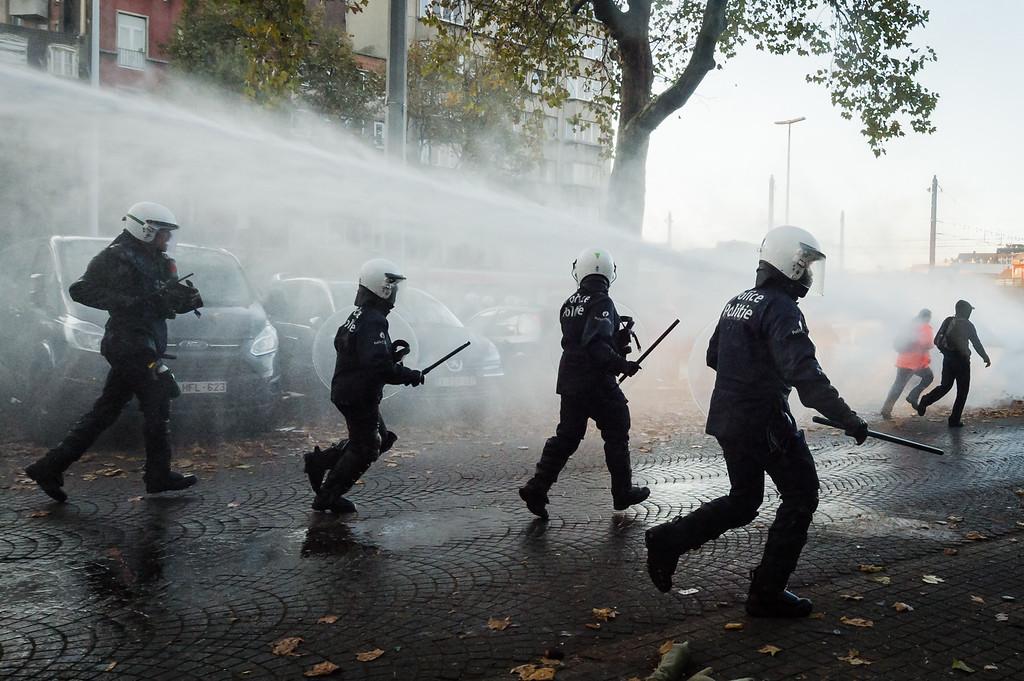 . Riot policemen charge during a national trade union demonstration in Brussels, Thursday Nov. 6, 2014.  (AP Photo/Geert Vanden Wijngaert)