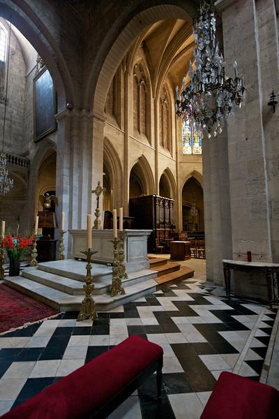 Inside St. Triomphe Church:  zig-zag white and black floor tiles.