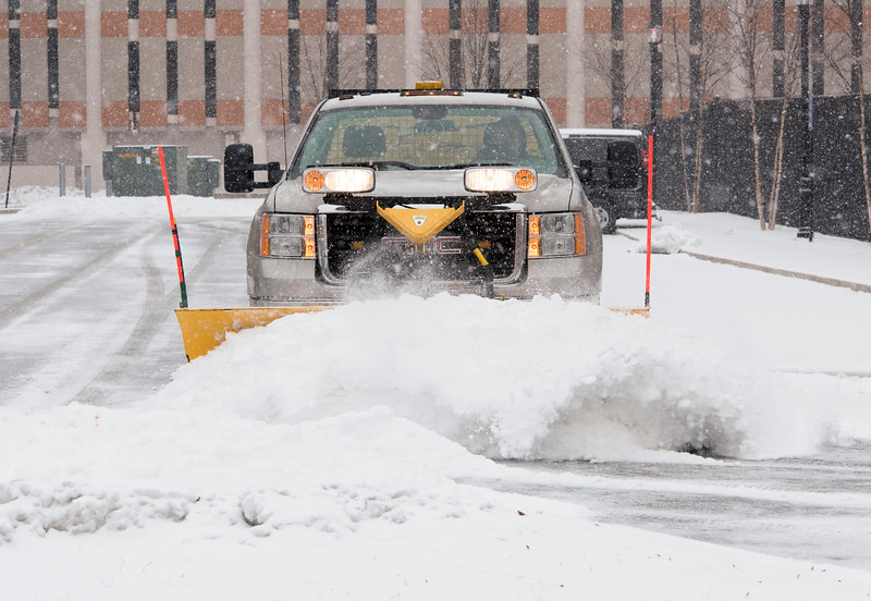 02/012/19  Wesley Bunnell | Staff  A snow plow clears the municipal parking lot during a snow storm on Tuesday afternoon on Main St behind the police station.