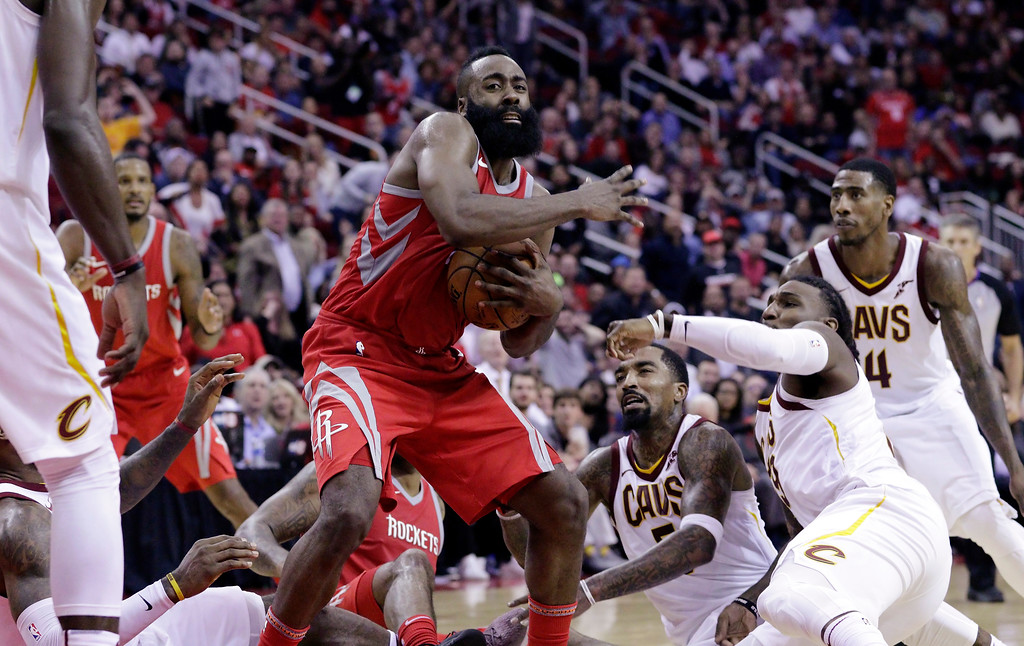 . Houston Rockets guard James Harden (13) looks to pass after coming up with a loose ball during the second half of an NBA basketball game against the Cleveland Cavaliers on Thursday, Nov. 9, 2017, in Houston. (AP Photo/Michael Wyke)