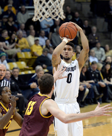 . Colorado\'s Askia Booker takes a shot in front of Jordan Bachynski during a game against Arizona State on Wednesday, Feb. 19, in Broomfield, Colorado.   Jeremy Papasso/Boulder Daily Camera