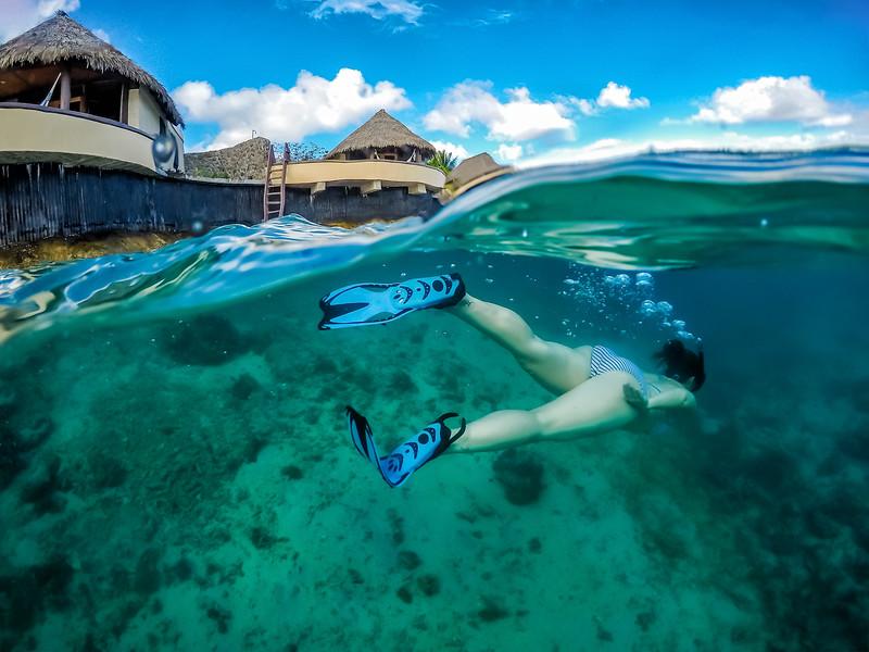 LIna Stock of the Divergent Travelers Adventure Travel Blog snorkeling in Vanua Levu.