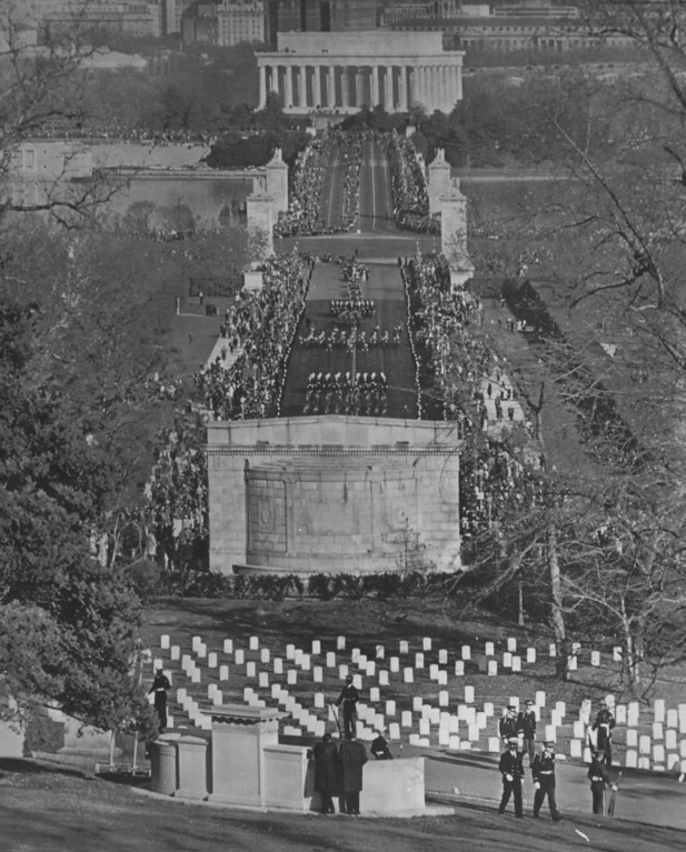 . The funeral cortege bearing the slain president\'s body crosses Memorial Bridge leading into Arlington National Cemetery.