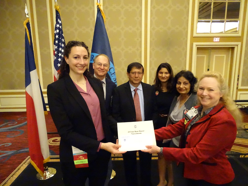 The 2018 Anita Mantri PhD Memorial Travel Scholarship is presented to Jennifer Fleischer (left) by Kim Broadwell representing the AsMA Foundation, and the Mantri family, Dr. Vish B. Mantri, PhD, PE, Trisha Mantri, and Mrs. Shubha Mantri, BS, MBA, with Dr. Valerie Martindale.