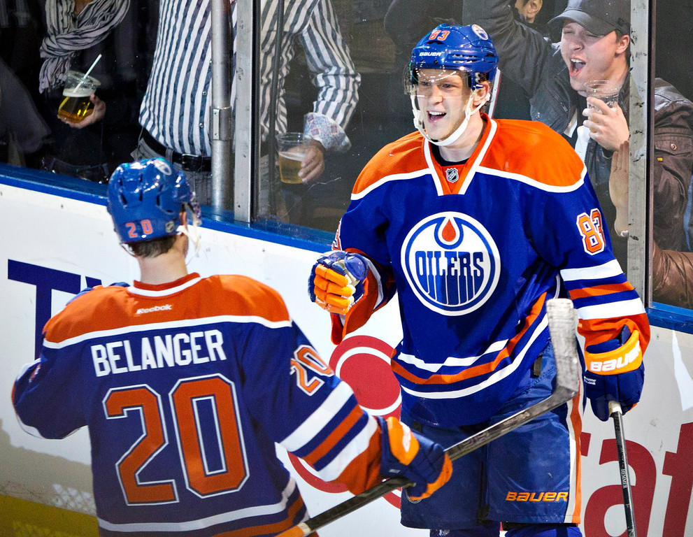 . Edmonton Oilers\' Eric Belanger, left, and Ales Hemsky, celebrate Hemsky\'s goal against the Colorado Avalanche during the second period of an NHL hockey game in Edmonton, Alberta, Saturday, Feb. 16, 2013. (AP Photo/The Canadian Press, Jason Franson)