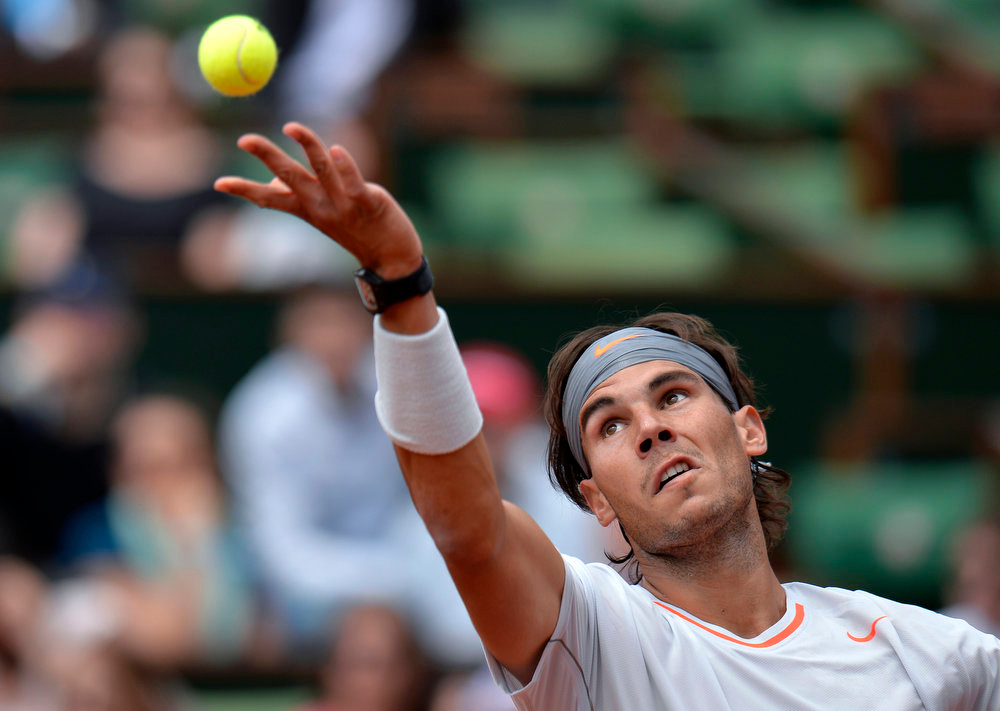 . Spain\'s Rafael Nadal serves to Germany\'s Daniel Brands during their French Tennis Open first round match at the Roland Garros stadium in Paris, on May 27,  2013. MIGUEL MEDINA/AFP/Getty Images