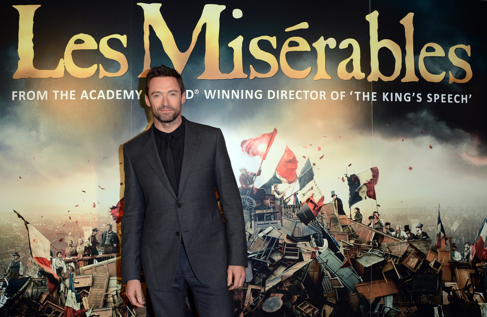 Description of . Actor Hugh Jackman poses for a photograph as he arrives at the after party for the premiere of Les Miserables at the Roundhouse, London, Wednesday, Dec. 5, 2012. (Photo by Jon Furniss/Invision/AP)