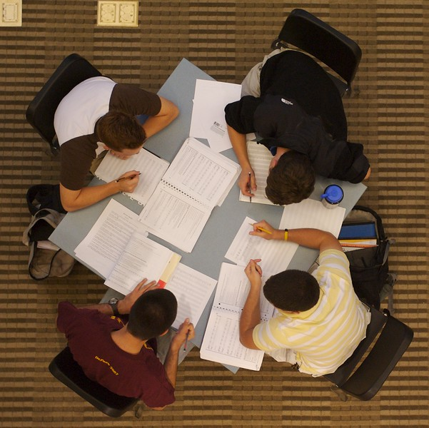 Sophomore's (clockwise from top) Steven Porter, Rob Meltzer, Nikolai Petrovic, and Nick Pearson work on homework in the new Green Center for the Performing Arts.