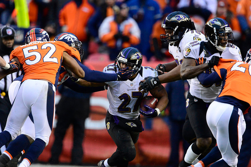 . Baltimore Ravens running back Ray Rice (27) runs up the middle for a short gain. The Denver Broncos vs Baltimore Ravens AFC Divisional playoff game at Sports Authority Field Saturday January 12, 2013. (Photo by AAron  Ontiveroz,/The Denver Post)