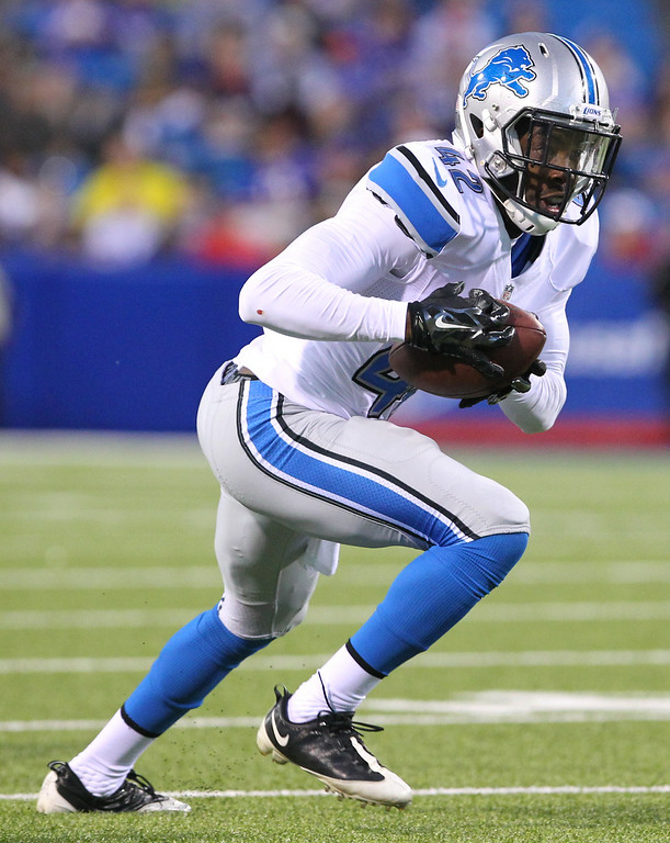 . Detroit Lions free safety Isa Abdul-Quddus runs with the ball after intercepting a pass from Buffalo Bills quarterback Jordan Palmer during the first half of a preseason NFL football game, Thursday, Aug. 28, 2014, in Orchard Park, N.Y. (AP Photo/Bill Wippert)