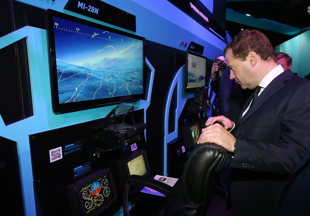 . Russia\'s Prime Minister Dmitry Medvedev visits the pavilion of the Rostechnologii Corporation at the MAKS International Aviation and Space Salon in Zhukovsky outside Moscow on August 27, 2013. AFP PHOTO / RIA NOVOSTI / POOL / EKATERINA SHTUKINA/AFP/Getty Images