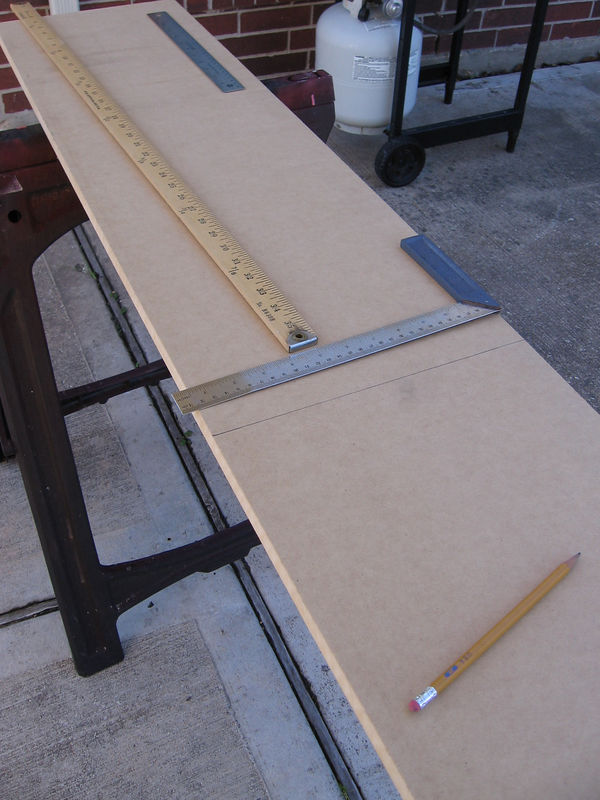 "You can cut out the 36"" lengths by measuring with a yard stick, then use a square to draw a perpenducular line across the board."