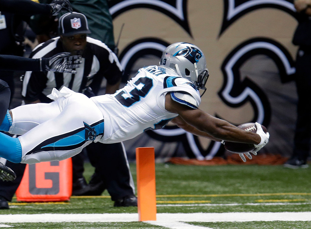 . Carolina Panthers running back Fozzy Whittaker (43) dives for a touchdown in the second half of an NFL football game against the New Orleans Saints in New Orleans, Sunday, Dec. 7, 2014. (AP Photo/Bill Feig)