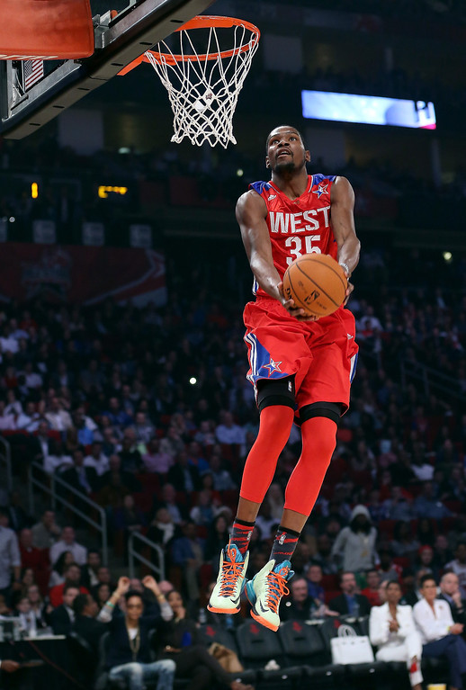 . HOUSTON, TX - FEBRUARY 17:  Kevin Durant #35 of the Oklahoma City Thunder and the Western Conference goes up for a reverse dunk in the first quarter during the 2013 NBA All-Star game at the Toyota Center on February 17, 2013 in Houston, Texas. (Photo by Ronald Martinez/Getty Images)