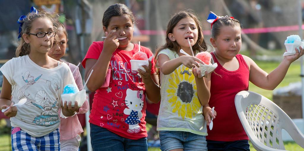 . Girls enjoy shave ice at La Mirada\'s annual Independence Day Celebration at La Mirada Regional Park July 3, 2013.   (SGVN/Staff photo by Leo Jarzomb)