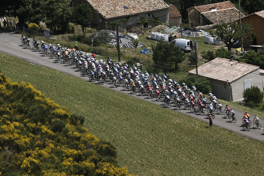 . The pack rides during the 168 km sixteenth stage of the 100th edition of the Tour de France cycling race on July 16, 2013 between Vaison-la-Romaine and Gap, southeastern France.    PASCAL GUYOT/AFP/Getty Images