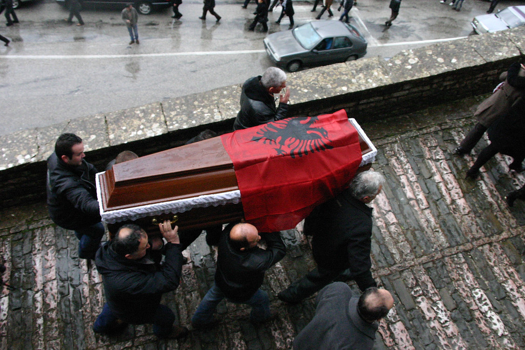 . Relatives carry the coffin of Ziver Veizi, during his funeral ceremony in Gjirokastra, 110 miles south of capital Tirana, Albania Sunday Jan. 23, 2011. Veizi and two others were killed during clashes outside the prime minister\'s office in the Albanian capital Friday. A political crisis has escalated in Albania as the government and the opposition traded blame for the deaths of three protests during a violent demonstration against an administration accused of deeply rooted corruption.  (AP Photo)