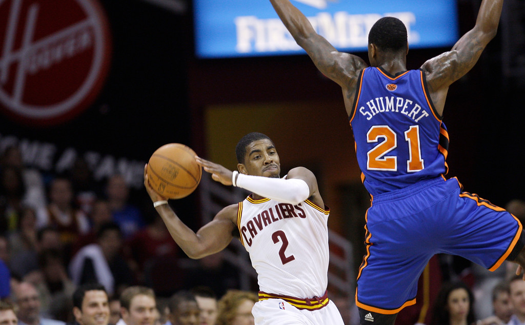 . Cleveland Cavaliers\' Kyrie Irving (2) looks for a teammate to pass the ball to under pressure from New York Knicks\' Iman Shumpert (21) in an NBA basketball game Friday, April 20, 2012, in Cleveland. (AP Photo/Tony Dejak)
